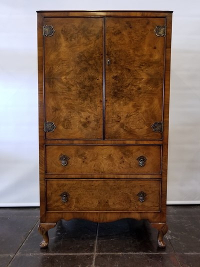 Carpathian Elm highboy from England features Anglo-Indian brass fixtures and Queen Ann feet with shell-on-knee.