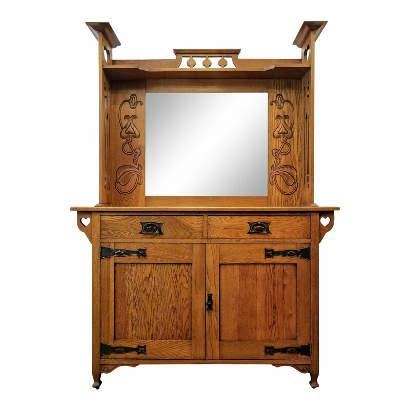 This Arts & Crafts sideboard with beveled glass mirror is constructed of plain oak wood.  Sideboard will suit Arts & Crafts, Craftsman, Mission, and Art Nouveau interiors and will complement collections including designs by C.R. Ashbee, Baillie Scott, Liberty, Charles Voysey, E.A. Taylor, Charles Rennie Mackintosh, and William Morris.