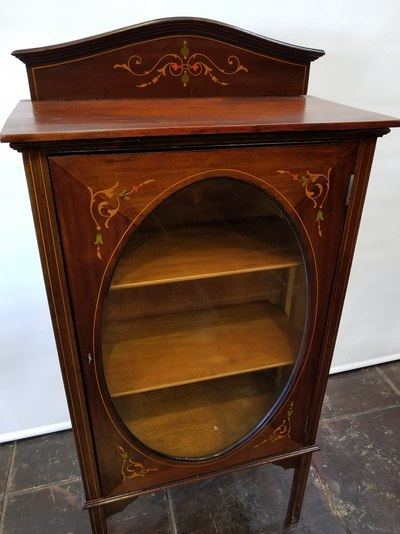 English Edwardian glass-front inlaid-wood bookcase.