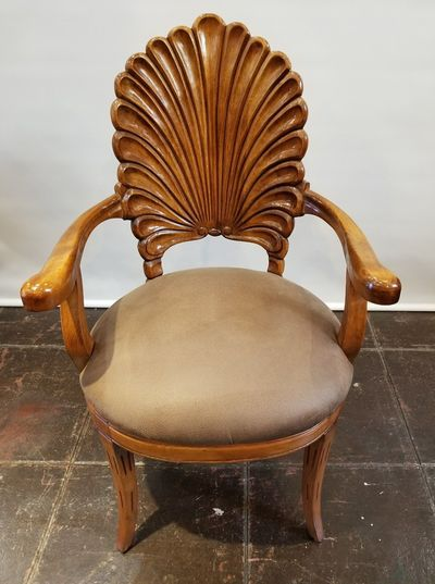 Mid-century (1960s-1970s) carved wood shell-back Venetian grotto armchair from Italy. Inspired by the late-19th century craze for grotto interiors. Will complement the shell-and-wave console tables designed by Edward Wormley for Dunbar Furniture.
