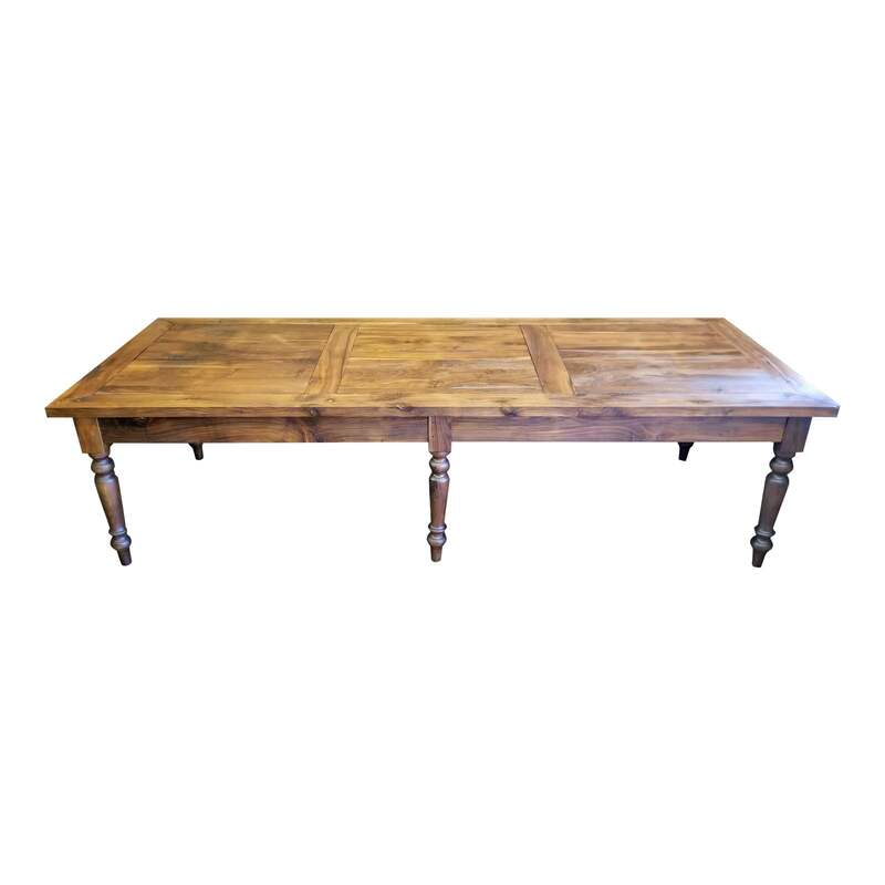 Large nineteenth-century rustic French farmhouse table is peg-constructed from walnut wood with turned legs and plank top.