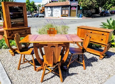 Seven piece dining suite with draw leaf table, four chairs, sideboard, and china hutch. Built in the 1920s in a style combining Art Deco and Provincial Revivalism.