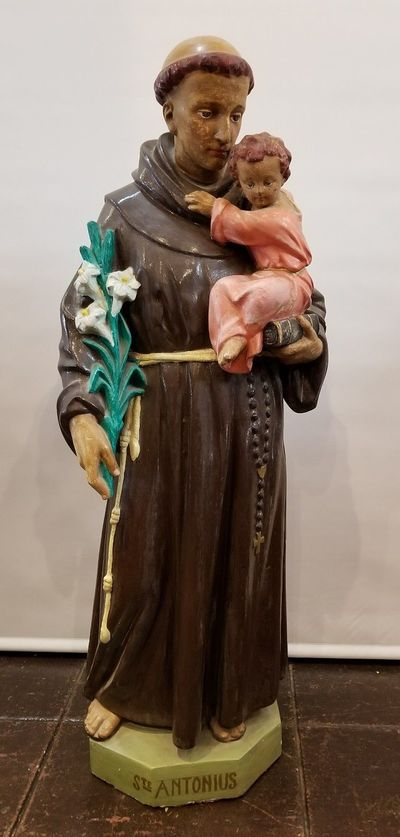Santo from Belgium portraying Saint Anthony of Padua, St. Antonius. He holds the Baby Jesus, a Bible, and a white lily stalk representing his purity.