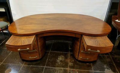 Large kidney shaped walnut art moderne desk.
