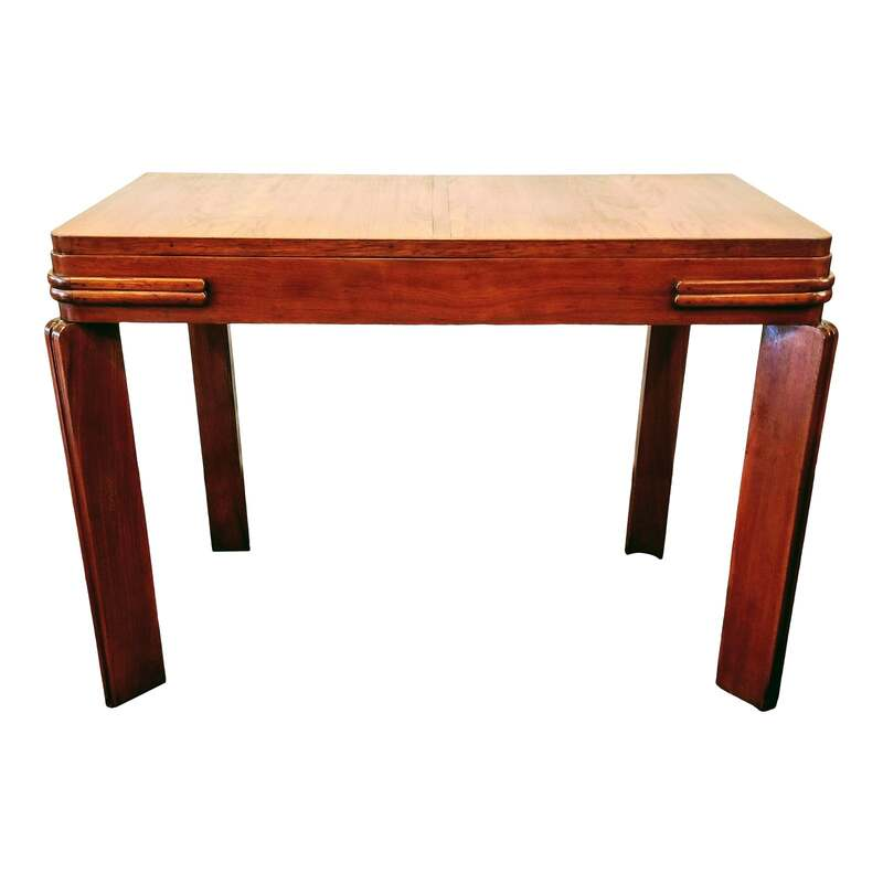 Beautiful and useful Streamlined Art Deco writing desk from England dates to the 1920s / 1930s.  Piece may also be utilized as a pier table, entry hall table, or server for dinner or tea.  Table is made with African Padauk Wood, also known as Vermillion. The heartwood is used on the top and the endgrain used for the legs.  SIZE:  41.75